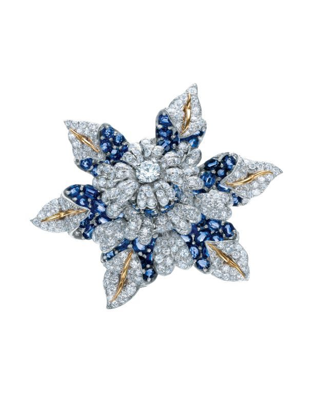 TIFFANY & CO. Jean Schlumberger's Fleur de Mer clip of diamonds, sapphires, platinum and 18 karat gold from the estate of Elizabeth Taylor
